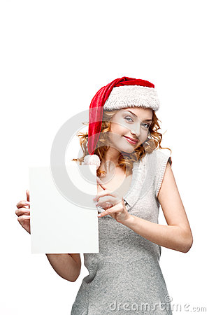Young casual girl in santa hat holding sign