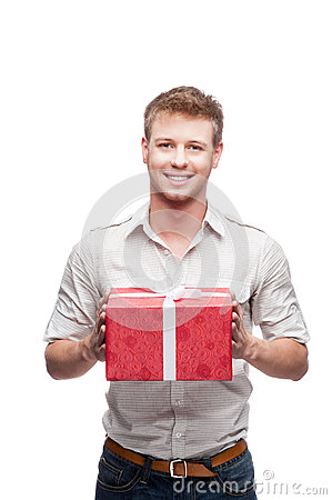 Young casual man holding red gift