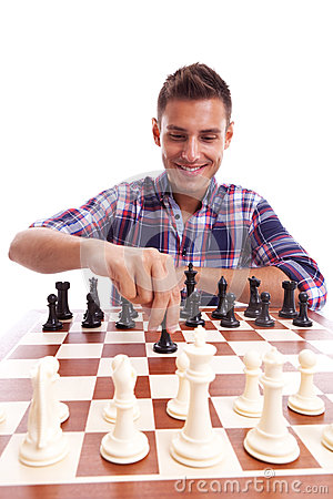 Young casual man playing chess