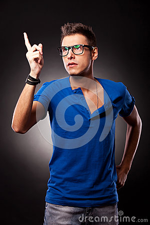 Young casual man pointing upwards