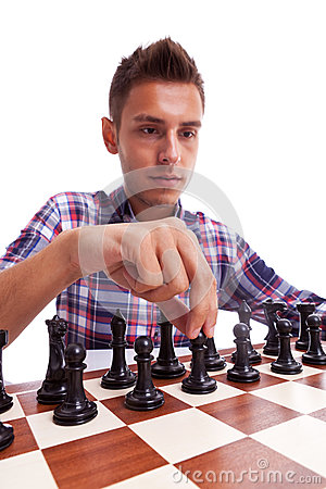 Young casual man preparing to make his first move