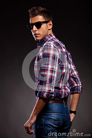 Young casual man with shades