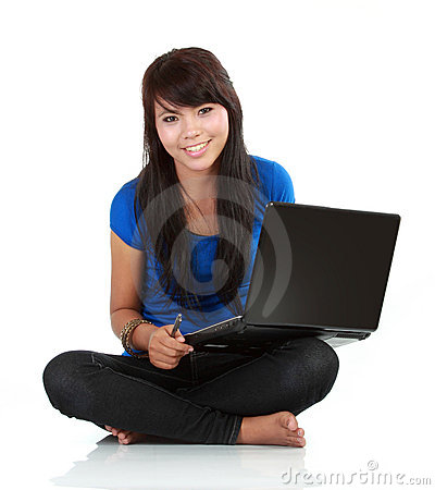 Young casual woman sitting holding laptop