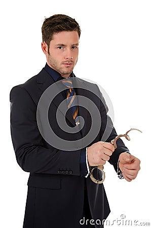 Young caucasian businessman, handcuffs