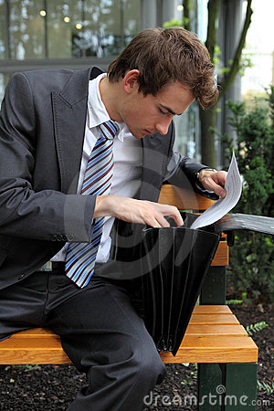 Young caucasian businessman in park