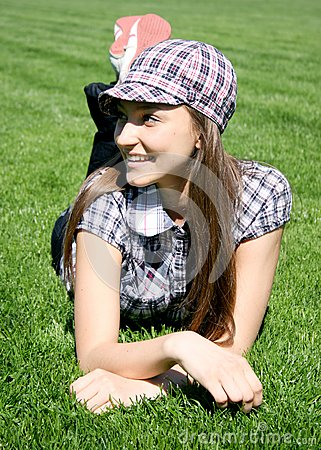 Young caucasian girl on the grass