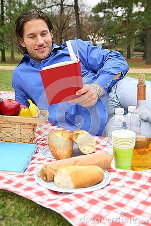 Young Caucasian Male Reading Book Outdoor