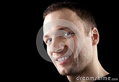 Young Caucasian man darkly smirks