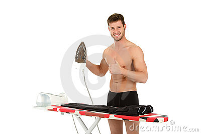 Young caucasian man ironing