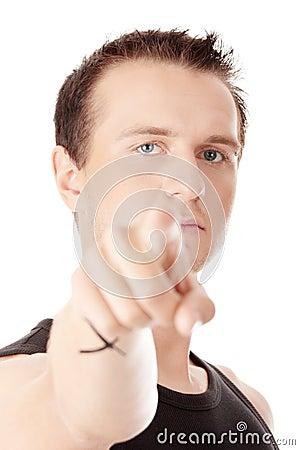 Young caucasian man, pointing at camera.