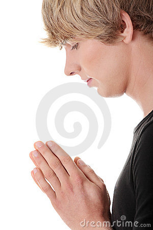 Young caucasian man praying