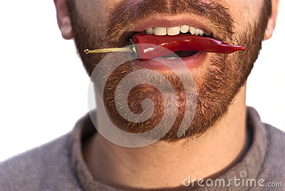 Man with a red hot chili pepper in his mouth