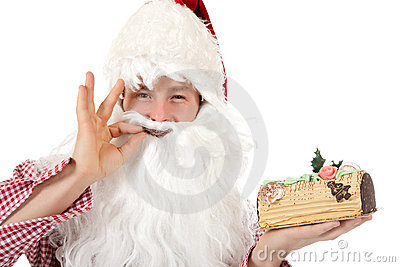 Young caucasian man Santa Claus, cake