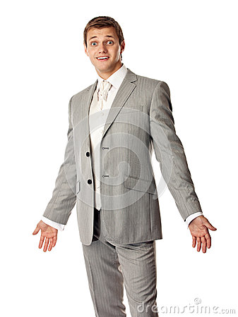 Young Caucasian man in a suit looking amazed