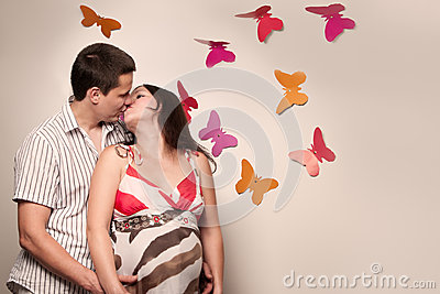 Young caucasian pregnant couple kissing