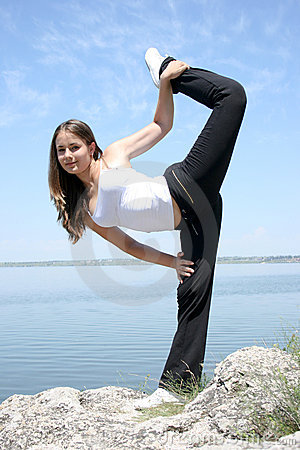 Young caucasian woman doing yoga exercises