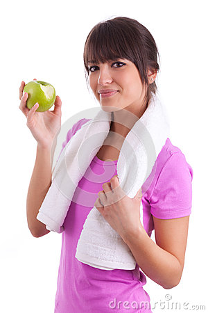 Young caucasian woman eating  an apple