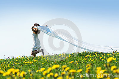 A young Caucasian woman on a flowerish field