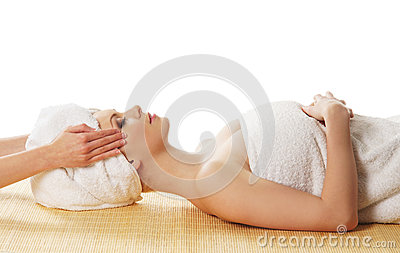 A young Caucasian woman laying on a spa procedure