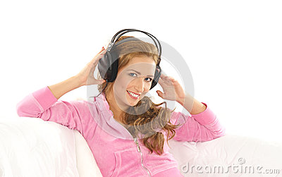 A young Caucasian woman listening to the music
