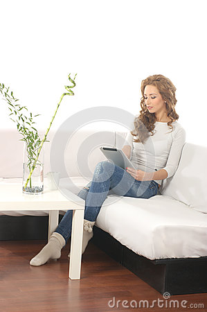 A young Caucasian woman in a modern interior