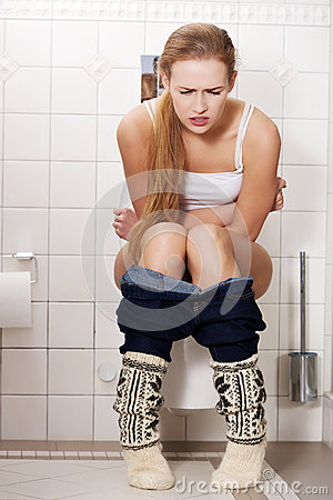 Question girl sitting on toilet peeing