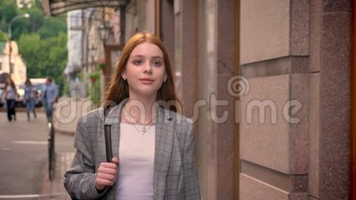 6c39dd7bff Young Charming Ginger Woman Walking In The City And Looking Sideways ...