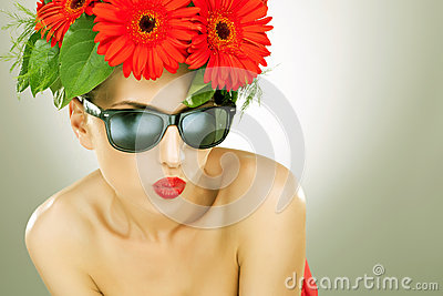 Young charming woman with flowers in her hair