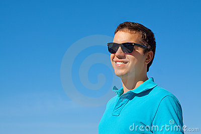 Young cheerful man in sunglasses