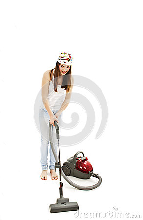 Young cheerful woman with vacuum cleaner