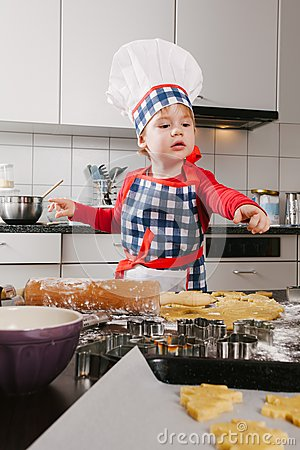 Young chef making cookies
