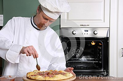 Young chef prepared italian pizza