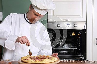 Young chef prepared italian pizza