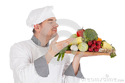 Young chef smelling aroma of vegetable
