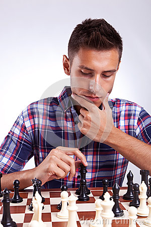Young chess player thinking about his next move
