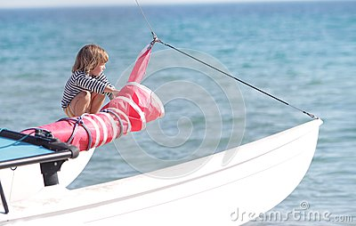 Young child on board of sea yacht