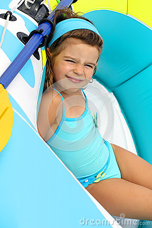 Young Child In A Boat Stock Image - Image: 25303101