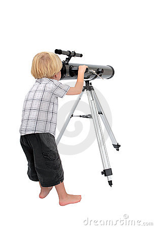 Young child or boy looking through a telescope