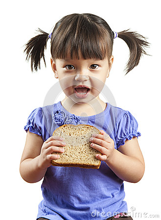 Young child eating sandwich