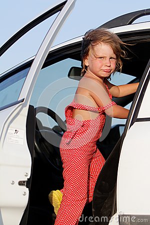Young child girl getting ready for car trip