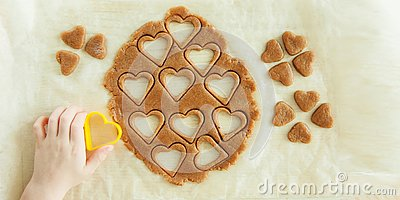 Young child hands is preparing the dough, bake cookies in the kitchen. Close up concept of family leasure Stock Photo
