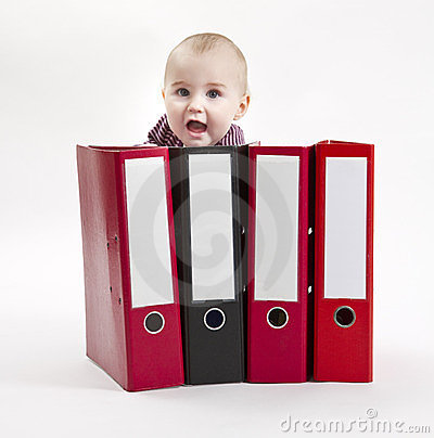 Young child hiding behind ring file