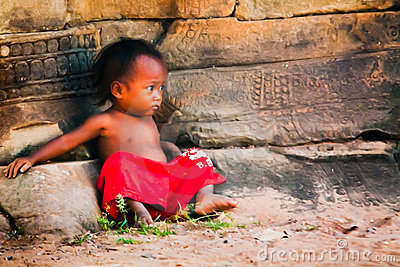 Young child looking alone in Cambodia Editorial Photography