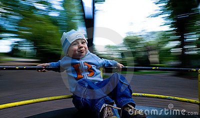 Young child on merry-go-round