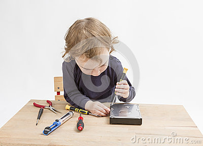 Young child opening hard drive