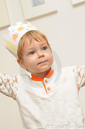 Young child with paper crown