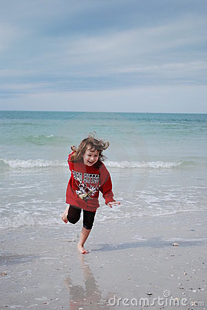 Young child playing at the beach