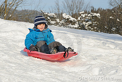 Young child on red sled