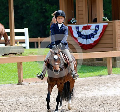 A Young Child Rides A Horse In The Germantown Charity Horse Show Editorial Photography
