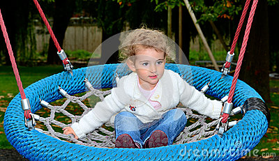 Young child on a rope swing